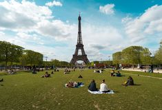 PARIS, FRANCE- June,16, 2018: Eiffel tower on a sunny day. PARIS, FRANCE- June,16, 2018: Eiffel tower on a lovely spring day landscape sunny grass green flowers royalty free stock photos