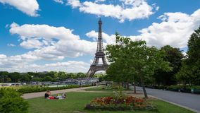 Eiffel Tower Timelapse Video over the Seine river. PARIS, FRANCE - JUNE 05, 2017: Eiffel Tower timelapse video from Trocadero Place. People having rest on a stock video