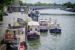 Residential barges along the Port des Champs Elysees Stock Images