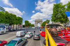 Paris, France - June 1, 2015: Great view from city tour bus driving through Champs Elysee Avenue. On a beautiful sunny day towards Arch of Triumph Stock Photos