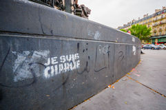 PARIS, FRANCE - JUNE 1, 2015 : Je suis Charlie graffity in a plaza in Paris against the terrorist attack on Charlie hebdo journal. Royalty Free Stock Photo