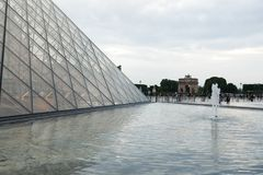 PARIS, FRANCE. 01 June 2018: Louvre Museum square during a summer sunset. stock photography