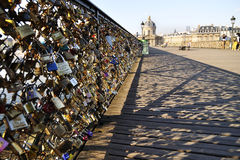 PARIS, FRANCE - JUNE 6., 2013: Lovers have locked thousands of locks to the Pont des Arts bridge in Paris. The padlocks, with keys Stock Photography
