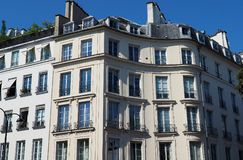 Mansion with curved facade listed as historic monument. PARIS, FRANCE - JUNE 29, 2018: A mansion whose curved facade are listed as historic monument since 1925 royalty free stock photography