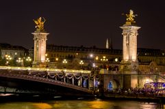 Night time over Pont Alexandre III bridge - Paris, France stock photography