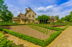 Paris, France - June 1, 2015: The Queens Hamlet, Versailles, built as a leisure retreat for her majesty and closest Royalty Free Stock Image