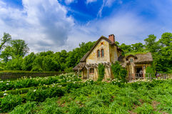 Paris, France - June 1, 2015: The Queens Hamlet, Versailles, built as a leisure retreat for her majesty and closest Royalty Free Stock Photography