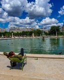Paris, France, June 2019: Relaxing in the Tuileries Garden royalty free stock image