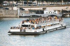 PARIS, FRANCE - JUNE 14, 2013: Seine River and Bateau Mouche in Paris, France Stock Photo