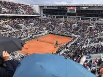 PARIS, France, June 7th, 2019 : Court Philippe Chatrier of the French Open Grand Slam tournament, in the rain before the stock photography