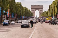 Traffic down the Champs Elysees Avenue and the Arc de Triomphe. Paris, France - 23 June 2018: Traffic down the Champs Elysees Avenue and the Arc de Triomphe Stock Photography