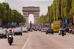 Traffic down the Champs Elysees Avenue and the Arc de Triomphe. Paris, France - 23 June 2018: Traffic down the Champs Elysees Avenue and the Arc de Triomphe Stock Photo