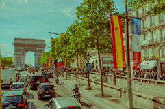 Paris, France - June 1, 2015: In traffic driving towards magnificent monument Arch of triumph.  Royalty Free Stock Photo