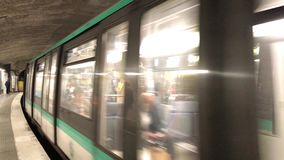 Train arriving on Paris metro station. PARIS, FRANCE - JUNE 2017: Train arriving at subway station. The Paris Metro is the second busiest metro system in Europe stock video footage