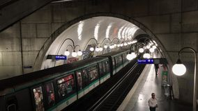 Train arriving on Paris metro station. PARIS, FRANCE - JUNE 2017: Train arriving at subway station. The Paris Metro is the second busiest metro system in Europe stock footage