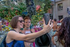 Woman taking a selfie at the 2018 Paris Gay Pride stock image