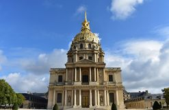 Paris, France. Les Invalides. Facade and golden dome. Blue sky with clouds. royalty free stock image