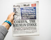 Male hand holding British Daily Mail newspaper with portrait of. PARIS, FRANCE - MAR 19, 2018: British Daily Mail newspaper with portrait of Stephen Hawking the Royalty Free Stock Image