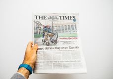 Stephen Hawking on cover of The Times. PARIS, FRANCE - MAR 19, 2018: Hand holding British newspaper The Times with portrait of Stephen Hawking the English Stock Photography