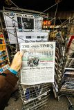 Stephen Hawking on cover of The Times. PARIS, FRANCE - MAR 15, 2018: Hand holding British newspaper The Times with portrait of Stephen Hawking the English Royalty Free Stock Photos
