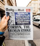 Male hand holding British Daily Mail newspaper with portrait of. PARIS, FRANCE - MAR 15, 2018: Male hand holding British Daily Mail newspaper with portrait of Stock Images
