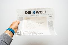 Newspaper about Stephen Hawking Death on the first page portrait. PARIS, FRANCE - MAR 15, 2018: POV at German Die Welt newspaper with caricature of Stephen Stock Image