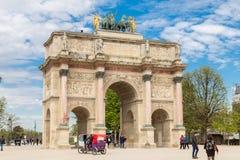 Paris, France, March 31 2017: The Arc de Triomphe du Carrousel is a triumphal arch in Paris, located in the Place du. Paris, France, March 31 2017: . The Arc de Stock Photography