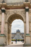 Paris, France, March 28 2017: The Arc de Triomphe du Carrousel is a triumphal arch in Paris, located in the Place du Stock Photo