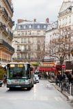Urban bus on Paris street Royalty Free Stock Image