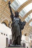 Paris, France, March 28 2017: A bronze replica of the Statue of Liberty by French sculptor Bartholdi stands in the Orsay Stock Photography