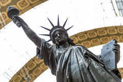 Paris, France, March 28 2017: A bronze replica of the Statue of Liberty by French sculptor Bartholdi stands in the Orsay Royalty Free Stock Image