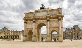 Paris, France - March 28, 2017: The Carrousel Triumphal Arch Arc de Triomphe du Carrousel in front of the Louvre.  Royalty Free Stock Photo