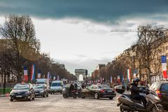 Champs Elysees and the Triumphal Arch in a cold winter day in Paris. PARIS, FRANCE - MARCH, 2018: Champs Elysees and the Triumphal Arch in a cold winter day in stock photo