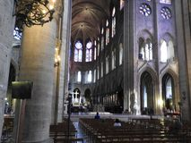 Paris, France - March 31, 2019: famous Notre Dame cathedral interior view. UNESCO World Heritage Site.  stock photo