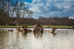 Fountain of Apollo at the garden of the Versailles Palace in a freezing winter day just before spring stock images