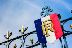 Paris, France - March 27, 2017: Gate with golden decoration and. French flag. Predidential elections concept royalty free stock photography
