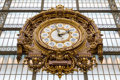 Paris, France, March 28 2017: Golden clock of the museum D`Orsay.The Musee d`Orsay is a museum in Paris, on the left. Bank of the Seine Royalty Free Stock Photo