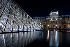 The Louvre Palace and the Pyramid, Paris at night Stock Images