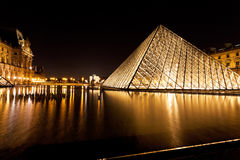 Glass Pyramid of Louvre, Paris at night Stock Photography