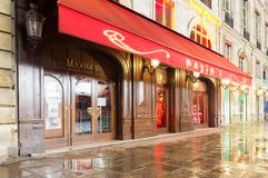 The famous restaurant Maxim at rainy night, Paris, France. Paris,France-MARCH 29, 2018: After more than 120 years of history, restaurant Maxim is one of the Stock Photography