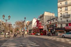 Paris, France, March 31 2017: Moulin Rouge is a famous cabaret built in 1889, locating in the Paris red-light district. Of Pigalle stock photo