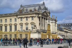 PARIS, FRANCE - MARCH 28, 2016: Palace of Versailles Chateau de. Versailles with tourists royalty free stock photo