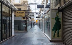 The famous parisian passage du Caire, France. Paris, France-March 24, 2018:The Passage du Caire is the oldest covered arcade in Paris. Situated in the Sentier Royalty Free Stock Image