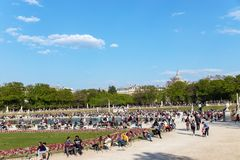 People enjoying sunshine in the Luxembourg garden on Sunday - Pa. Paris, France - March 31, 2019: People enjoying sunshine in the Luxembourg garden on Sunday stock image