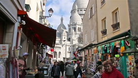 PARIS, FRANCE - March 22, 2016 :People walking on streets of Montmartre stock video footage