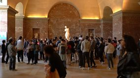 Paris, France - March 31, 2019: Tourists visit The Venus de Milo statue at the Louvre Museum. Paris, France - March 31, 2019: Tourists visit The Venus de Milo stock video