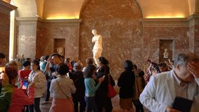 Paris, France - March 31, 2019: Tourists visit The Venus de Milo statue at the Louvre Museum. Paris, France - March 31, 2019: Tourists visit The Venus de Milo stock footage