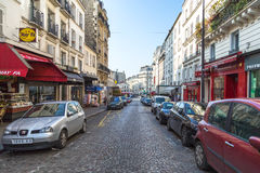 Paris, France, March 26, 2017: View on narrow cobbled street among traditional parisian buildings in Paris, France. Royalty Free Stock Photo