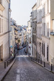 Paris, France, March 26, 2017: View on narrow cobbled street among traditional parisian buildings in Paris, France. Stock Photography