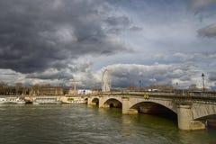 Paris, France. March 30, 2018. View on river Seine. Ferris wheel Roue de Paris and cloudy sky royalty free stock image